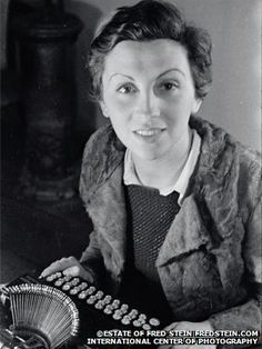 Gerda Taro sitting at a typewriter.  In July 1937 a Jewish emigre from Nazi Germany became the first female war photographer to die on assignment. At the age of 26, Gerda Taro was just starting to make a name for herself and had already helped launch the career of the young Robert Capa.