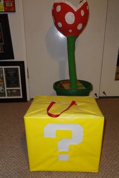 "Square boxes wrapped in yellow wrapping paper with ""?"" on, hanging from ceiling/walls/stacked on floor - Super Mario party"