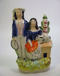Antique Staffordshire pottery figure-boy & girl with rabbit