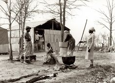 """November 1939. Butler County, Missouri. """"Washing clothes at camp for evicted sharecroppers."""" by Arthur Rothstein. Somehow, despite all odds, life went on and the necessary jobs of life got done."""