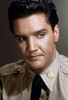 .Elvis grim.
