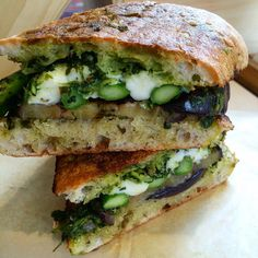 Grilled eggplant and asparagus -- topped with slices of fresh mozzarella, smothered in home-made salsa verde. Served warm and toasty on olive ciabatta.