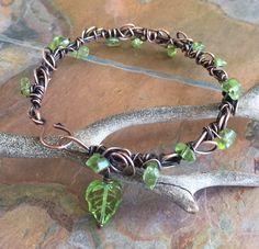 Wire Wrapped Peridot Antiqued CopperBracelet ,Adjustable Peridot bracelet,August Birthstone Bracelet,Copper Bangle/Cuff Leaf Wrap bracelet, by SunVDesigns on Etsy https://www.etsy.com/listing/288667729/wire-wrapped-peridot-antiqued