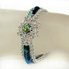 """Ethereal"" - Swarovski vitrail medium in a Aura 6 captive, blue and green tiny scales.  Original design, Torild Larsen"