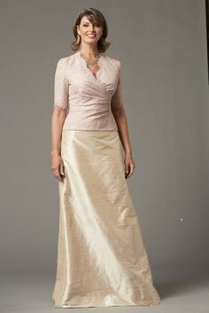This two piece suit-style Watters Collection 20 72442 Mothers of the Wedding gown consists of a structured jacket and crisp, full length, A-line skirt. The wrap style jacket is draped on the side and made of beautiful Pippa lace over a Dupioni silk lining. #timelesstreasure