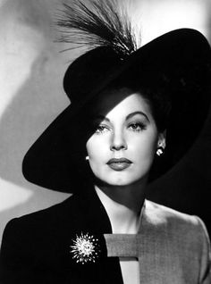 How to wear a hat. Ava Gardner. Capricorn Sun. Nice Leo brooch there too.