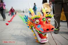 A 100-meter long dragon kite ready to take off on Saturday, April 11, 2015 at the opening ceremony of the 2015 Beijing International Kite Flying Festival.