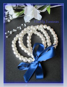 Ivory Glow  Pearl three stranded bracelet by FireflyFantasies1,