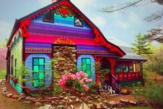 Prolific artist Kat O'Sulllivan, also know as Katwise, has given an old farmhouse near Woodstock, NY a rainbow-colored renovation. Rainbow House, Woodstock Ny, Old Home Remodel, House In The Woods, Oeuvre D'art, Architecture, House Colors, Feng Shui, House Design