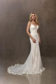 Jacquelin Bridals Canada - 19097 - Wedding Gown - This soft, A-line gown is made of lightweight Chantilly lace appliques that begin at the neckline and work their way past the waist and to the skirt. Godets have been added to the skirt to make a soft fullness