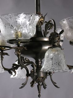 """Circa 1895, 4&4 Gas and Electric Chandelier... Cast arms throughout  with Rococo details on shades and Chandelier. Transfer etched gas and electric shades with heart & foliate design detail. 29"""" drop x 24"""" diameter. Drop can be adjusted if desired.   Available : 1  During the late 1800's, around the beginning of the use of electric incandescent lighting, the Gas and Electric Chandelier is also called transitional combination and G & E form .  $3415.00 SOLD"""