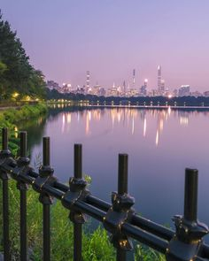 Jacqueline Kennedy Onassis Reservoir Running Track at Central Park New York with City lights background. Running Track, Jacqueline Kennedy Onassis, Lights Background, Meet The Artist, City Lights, Buy Frames, Central Park, Cn Tower, Gallery Wall