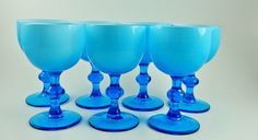Rare Murano Carlo Moretti Midcentury Cased Light Blue  Cordial Glasses Set of 7 Barware by MSMUnlimited on Etsy https://www.etsy.com/listing/227196240/rare-murano-carlo-moretti-midcentury