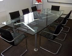 Awesome DIY design for an metal and glass dining table with that industrial look.