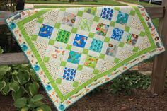 "Baby Quilt in ""Bungle Jungle"" Charm Fabrics with Zoo Animals for Boy or Girl in Green and White, with Turquoise Blue, Red, Yellow"