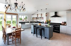 The perfect space for parties and entertaining, this kitchen by Earle & Ginger has a dinin...
