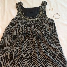 Beautiful Beaded Neck Line Chevron Top Pretty chevron blouse with beaded neck line. Great for going out on the town or just going out! Is in very good condition but is not new, is missing a small minor bead but is not noticeable. This listing is for the top only. Express Tops Blouses