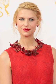 Claire Danes' style was something of a riddle — was it a fishtail braid or a chignon? It was both, actually. Hairstylist Peter Butler sprayed in some Leonor Greyl Laque Souple into Claire's hair to give it texture, before weaving it into a fishtail. (Fun fact — he actually had to redo the braid three times to get it right.) Butler then twisted it into a chignon, which complemented her crimson lips and firey red dress beautifully.