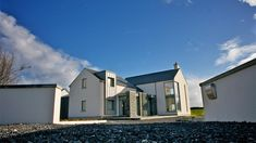 Designed as an evolution of the traditional form and located next to the main Sligo-Donegal road, the super insulated and triple glazed house minimises the noise pollution from the busy road in addition to its energy rating. House Designs Ireland, Noise Pollution, Architects, Minimalism, Exterior, Traditional, Mansions, House Styles, House Ideas
