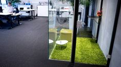 Grass carpet in office phone booth