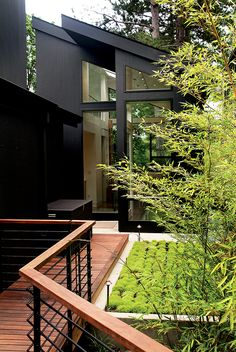 Black exterior ideas for a hauntingly beautiful home country rustic . exterior handrail ideas mobile home Black House Exterior, Modern Exterior, Exterior Colors, Exterior Paint, Exterior Design, Interior And Exterior, Modern Entry, Exterior Windows, Exterior Homes