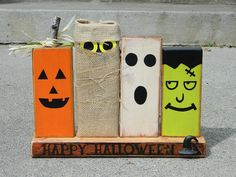 Primitive Halloween decoration with wooden monsters pumpkin ghost Frankenstein and ghoul happy halloween.