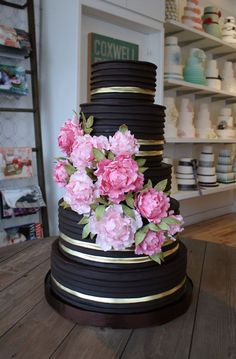"""Gold and black wedding cake with gorgeous pink flowers. We can help achieve this look at Dallas Foam with cake dummies, cupcake stands and cakeboards. Just use """"Pinterest2013"""" as the item code and receive 10% off @ www.dallas-foam.com"""