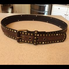 "Brown leather belt w/bronze and silver studs Brown leather belt, very gently barely used. Excellent condition, bronze studs run above and below the belt, w/silver ones scattered throughout.  All studs intact.  Length 40"" x 1.5"" wide. Accessories Belts"