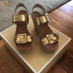 Michael Kors gold wedges Super cute summer wedges. Worn a few times! Cute little more emblem on the wedge. MICHAEL Michael Kors Shoes Sandals