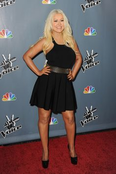 Christina Aguilera Little Black Dress - X-tina showed off her rockin' body in an LBD with a cut out back and flouncy skirt, which she paired with a studded belt for an extra edgy look.