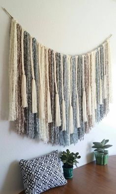 This is a large yarn wall hanging or banner that would make a great statement piece above a bed or sofa. I have braided/knotted acrylic yarns to a single strand of jute twine.There are loops on each side for easy hanging. This is a cozy, modern wall decoration that would add a touch of softness to any space. The size is approximately 40 long from hanging loops to longest center strand and 49 wide when hanging as pictured in first photo. Feel free to message me for any questions.