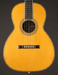 This Martin 00-30 from 1903 has a quality of tone that is purely sublime, combining the best aspects of steel and gut into one magical instrument. Martin Acoustic Guitar, Small Bridge, Hard Pressed, Guitars, At Least, Instruments, Delicate, Steel, Music