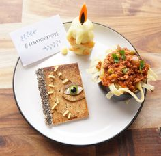 This lunch will put a spell on your kids! Jacob's Food Diaries whipped up a Hocus Pocus-themed kids lunch, featuring a whole wheat wrap book with cream cheese, chia seeds, cucumber, eggplant skin, and cheese, an eggplant cauldron with spaghetti bolognese, and a black flame candle made of potato, melted cheese, and carrot and eggplant skin. #LunchboxLove