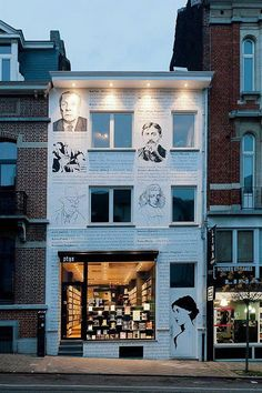 Librairie Ptyx, Brussels, Belgium Sure, it's really the whole façade that catches the eye, but that big picture window is like a set of lovely eyes in a pretty face.