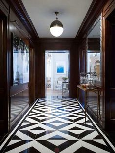 Black And White Tile Floor Hallway With Geometric Tiles Large Mirrors