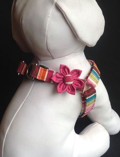 The step in dog harness is sold with or without the flower. For matching leash click on the following link https://www.etsy.com/listing/150362712/dog-leash-colorful-sripes The step in dog harness is made out of a colorful striped cotton fabric. I use heavy interfacing, quality nickel plated d rings and a contoured side release buckle. The step in dog harness is box stitched at all stress points which makes all my dog harnesses durable and safe to use. The beautiful flower is handmade. The…