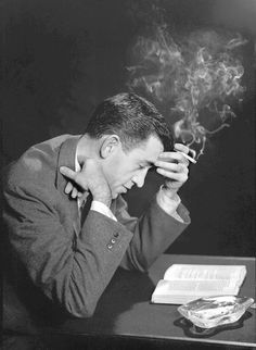 """books0977:  Author J.D. Salinger poses for a portrait as he reads from his classic American novel """"The Catcher in the Rye"""" on November 20, 1952, in Brooklyn. San Diego Historical Society. """"What really knocks me out is a book that, when you're all done reading it, you wish the author that wrote it was a terrific friend of yours and you could call him up on the phone whenever you felt like it. That doesn't happen much, though."""" ― J.D. Salinger, The Catcher in the Rye"""