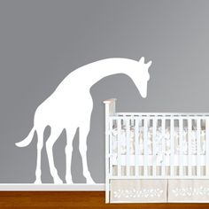 Leaning giraffe wall decal.  But I would like to see it in pink with brown spots cause she is going to love giraffes!