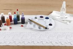 Apply dye with a brush to create multicolored effects on lace.