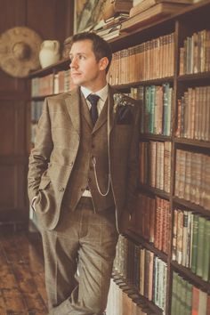 Groom wears a three piece chequered brown suit with navy tie and pocket square   Photography by http://michellelindsell.com/