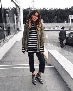 Moda Tutkusu rocks stripes and an army jacket. Cropped pants...