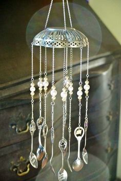 Windchime made from a filigree silver bowl, souvenir spoons.