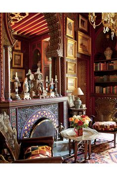 MIRROR, MIRROR   In the library, entirely designed by Willis, employing traditional wood-carving and stenciling techniques, armchairs from Brazil once belonged to the decorator. On the wall hangs Bergé's collection of Orientalist paintings.