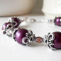 Hey, I found this really awesome Etsy listing at https://www.etsy.com/listing/150914169/plum-pearl-bracelet-in-silver-bridesmaid
