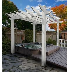 The pergola is a thing of beauty. They can be bought completely built, in ready-to-assemble kits or custom built to fit perfectly over your back deck. Love how the deck is built around the hottub
