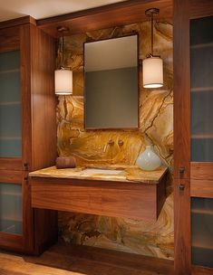 Vanity with minimalist wood cabinet and stone slab #bathroom