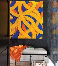Sara Sosnowy's painting Ribbons makes a bold statement in a bedroom hallway. Chahan bench, from 21st Twenty First, is upholstered in Moore & Giles Pompeii leather. Cashmere throw, Pratesi.   - HouseBeautiful.com