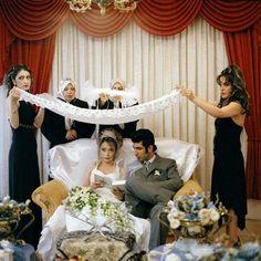 Olivia Arthur. IRAN. 2007. Tehran. A family perform wedding rituals at a public wedding-hall in Tehran.