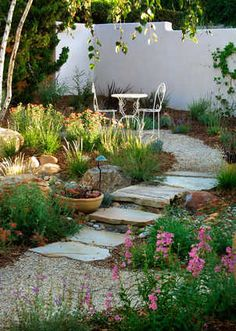 Stepping stones leading to small garden setting