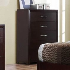 Enhancing the contemporary design of your bedroom is the focus of the Edina Collection. The espresso-hinted cherry finish builds on the unexaggerated lines of this bedroom suite, blended with the tufted bi-cast vinyl inserts on the headboard and the polished nickel hardware, culminates to achieve...